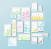 Different pictire frames with simple colorful geometric patters on bright blue wall. Set of realistic borders for art gallery mockup, wallpaper design, fully Royalty Free Stock Photo