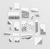 Different pictire frames with simple grey geometric patters on white wall. Different pictire frames with simple grey monochome geometric patters on white wall Stock Photography