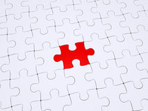 Different piece of the puzzle. One red puzzle piece amongst white ones Stock Photo