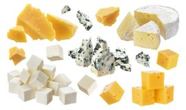 Different pieces of cheese. Cheddar, parmesan, emmental, blu cheese, camembert, feta isolated on white background. With clipping path stock photo