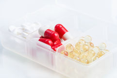 Different pills in the box Stock Image