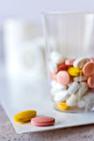 Different pills in  a cup - health care system Royalty Free Stock Images
