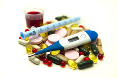 Different pills, medications   with medicine with a syringe and with thermometer on white background closeup. Stock Photo