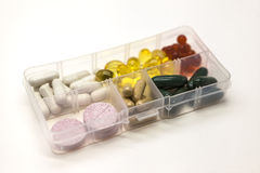 Different pills, medications, the pills in the box for drugs closeup on white background. Royalty Free Stock Image