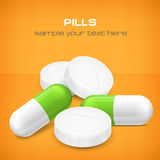 Different pills on yellow Royalty Free Stock Image