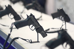 Different pistols models on store shelves. Weapon stock image