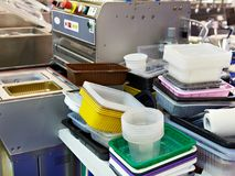 Different plastic containers in food factory. Different plastic containers in the food factory Royalty Free Stock Images