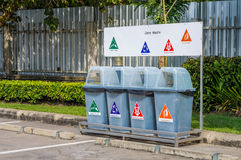 Different plastic trash cans or garbage bins in public area Stock Photography