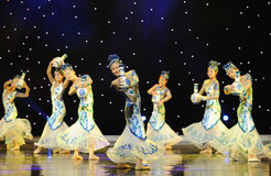 In different poses and with different expressions ---Folk dance of blue and white porcelain Stock Images