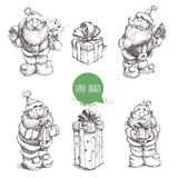 Different poses set of hand drawn Santa Claus and gift boxes. Stock Images