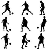 Different poses silhouettes of soccer players with Royalty Free Stock Image