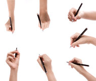 Different positions of hands with pens Royalty Free Stock Photos