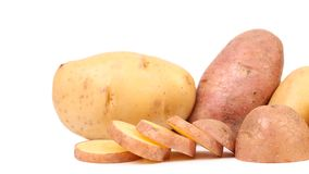 Different potatoes and split tuber. Stock Images