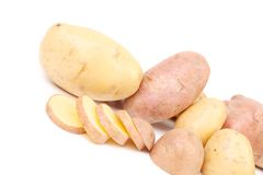 Different potatoes and split tuber Royalty Free Stock Photos