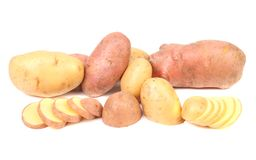 Different potatoes and splited tuber. Royalty Free Stock Photo