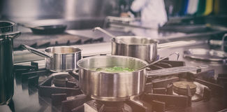 Different pots cooking on hotplate Royalty Free Stock Images
