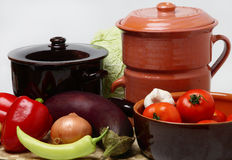 Different pots and vegetable. On table Stock Image