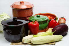 Different pots and vegetable. On table Royalty Free Stock Photo