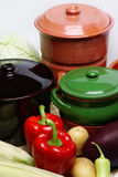 Different pots and vegetable. On table Royalty Free Stock Photos