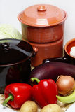 Different pots and vegetable. On table Stock Photo