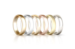 Different precious metals rings set stand isolated, golden, silver, pink Royalty Free Stock Photos