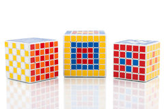 Different puzzle cubes Stock Image