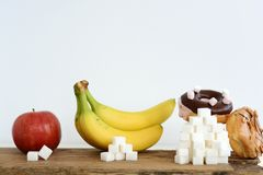 Different level of sugar in food, eating habits concept. Different quantity of sugar in food, eating habits concept stock image