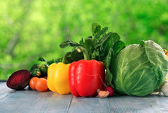 Different raw fresh vegetables оn blue wooden table cloe up Royalty Free Stock Photo