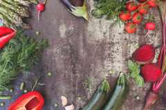 Different raw vegetables on table. Variety of freshly harvested organic vegetables, rustic background. Top view, vintage toned image, blank space Royalty Free Stock Photo