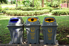 Different recycle bin of recycled materials in the park.  Royalty Free Stock Photos