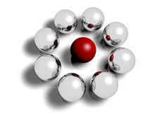 Different. Red ball in the middle of a circle of silver balls Royalty Free Stock Photos