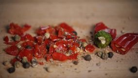 Different red hot pepper spices freshly ground on wooden background. Top view, jalapeno mexican stock video
