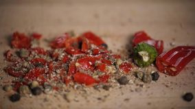 Different red hot pepper spices freshly ground on wooden background. Top view, jalapeno mexican stock video footage