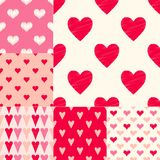 Different red pink color combinations of heart symbols textured vector pattern. Red pink color combinations of heart symbols. Textured vector pattern. 6 in 1 set royalty free illustration