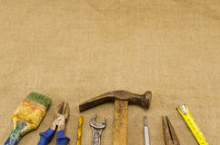 Different retro construction work tools on linen Royalty Free Stock Photo