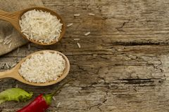 Different rice in spoons on wooden background. Healthy eating, diet Stock Photography