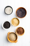 Different rice varieties. Different rice varieties in bowl. Top view Stock Photography