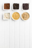 Different rice varieties. Different rice varieties on kitchen table. Top view Royalty Free Stock Photo