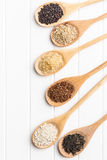 Different rice varieties. Different rice varieties on kitchen table. Top view Royalty Free Stock Image