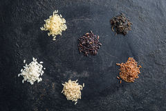 Different rice varieties. Different rice varieties on old table. Top view Stock Images