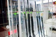 Different rifles on shelves store weapons on shop center. Stock Image