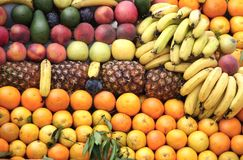 Different ripe fruits in supermarket royalty free stock photos