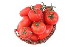 Different Ripe Tomatoes in wicker basket Royalty Free Stock Images