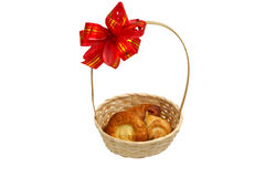 Bread in a basket with a bow. Different rolls in a basket with a red bow Stock Photography