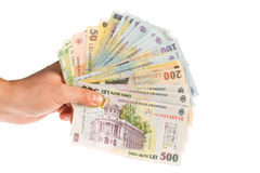 Different romanian banknotes. Man hand holding romanian money like a fan Royalty Free Stock Photo