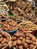 Different root vegetables and potatoes for sale from buckets on local market in Cameroon, Africa Stock Photo