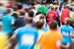 Different runners at the marathon from behind stock photography