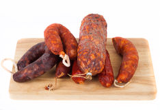 Different salami on a white background Stock Image