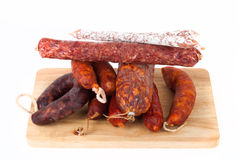 Different salami on a white background Stock Images