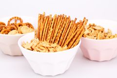 Crackers. Different salted crackers in bowls on white background Stock Photography